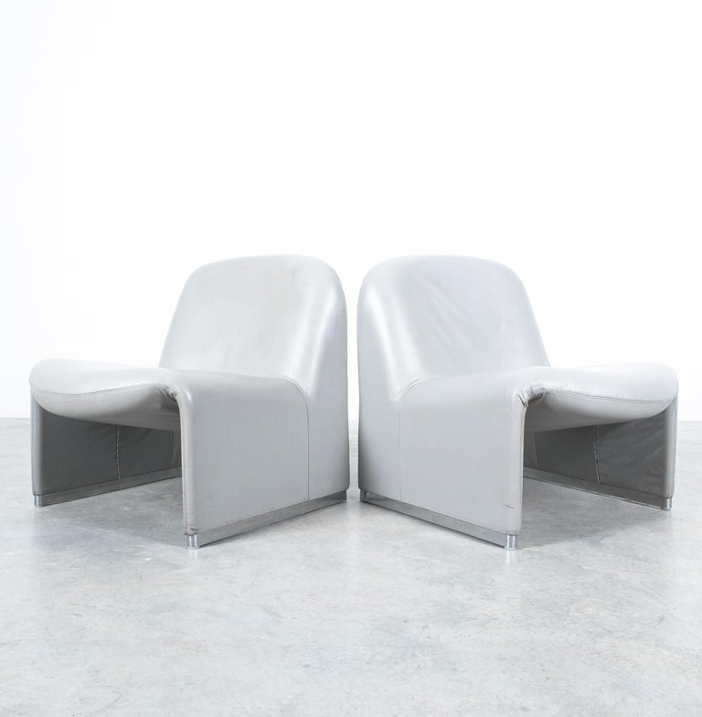"""A pair of Giancarlo Piretti """"Alky"""" lounge chairs originally upholstered with grey leather, manufactured by Castelli in the 1970s.  Great original condition with the foam still being intact and exactly the right amount of sturdiness, the organic"""
