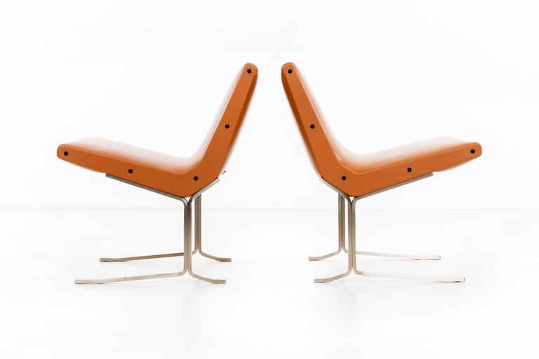 These very low-slung lounge chairs have a spare style that is somewhat Kjaerholmian in pictures, but in person they are really quite distinctive and unusual. Made by Formanova circa 1969, they were just reupholstered in Spinneybeck (Italian) leather.