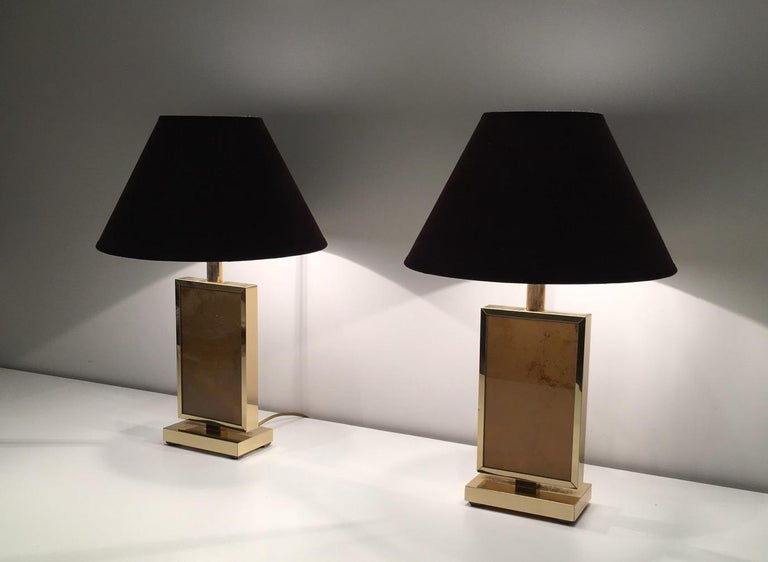 This pair of lamps is made of gilt metal with a nice oranheish decor on each side. These table lamps are very decorative. This is a French work in the style of famous Italian artist Aldo Tura, circa 1970.