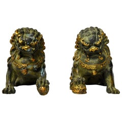 Pair of Gilded Bronze Foo Dogs