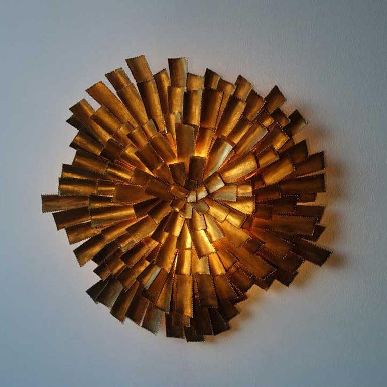Bright, sparkling and adorable pair of wall sconces sunburst shaped structure in gilded metal at the manner of Svend Aage Holm Sørensen.