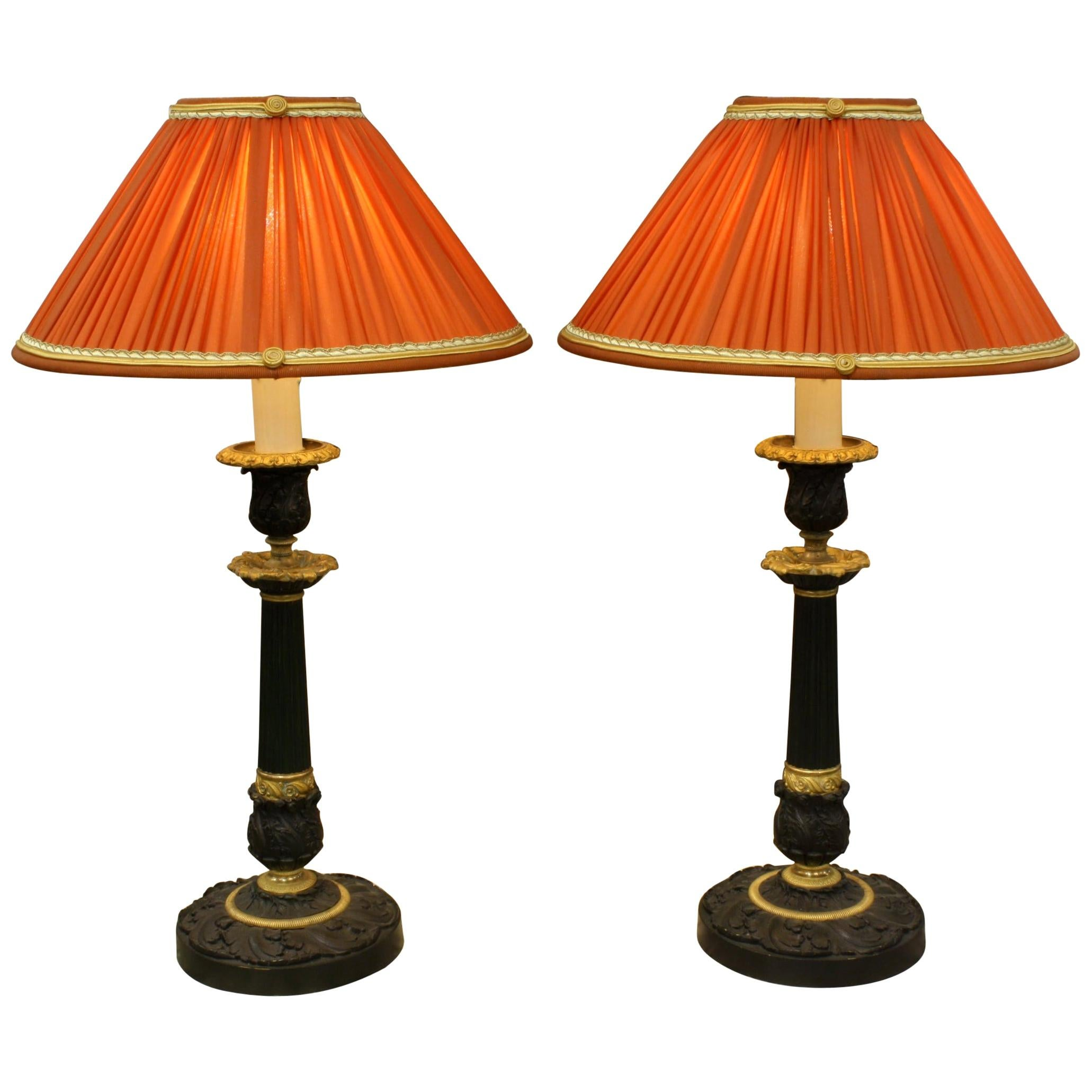 Pair of Gilt and Patinated Bronze Candlestick Lamps with Orange Silk Shades