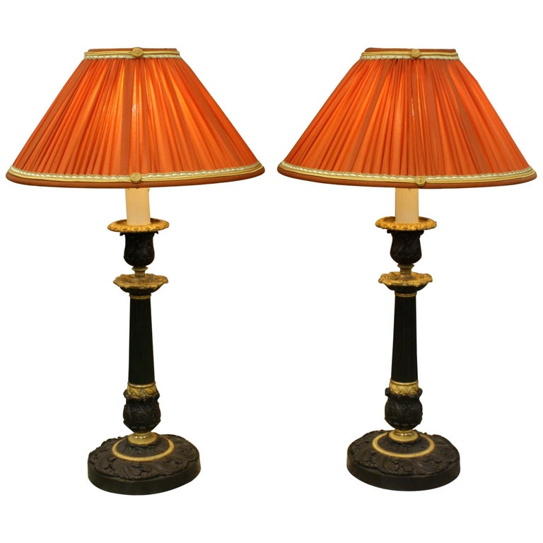Pair of Gilt and Patinated Bronze Candlestick Lamps with Orange Silk Shades For Sale
