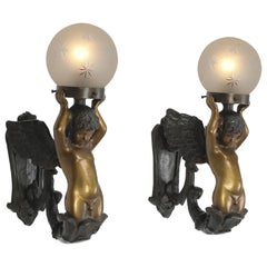 Pair of Gilt and Patinated Bronze Cherub Wall Sconces