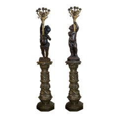 Pair of Gilt and Patinated Bronze Putti Torchères and Marble Pedestals