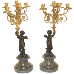 Pair of Gilt and Patinated Figural Bronze and Marble Candelabras