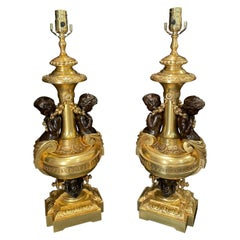 Pair of Gilt and Patinated Putti Lamps