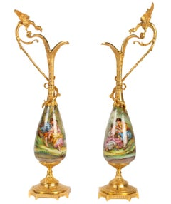 Pair of Gilt Bronze and Porcelain Ewers Topped with a Winged Dragon