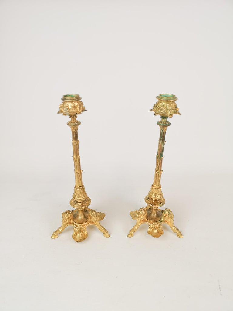 This pair of candle sticks in gilt bronze are from the 1900 century most certain made in Sweden 1870-1880.