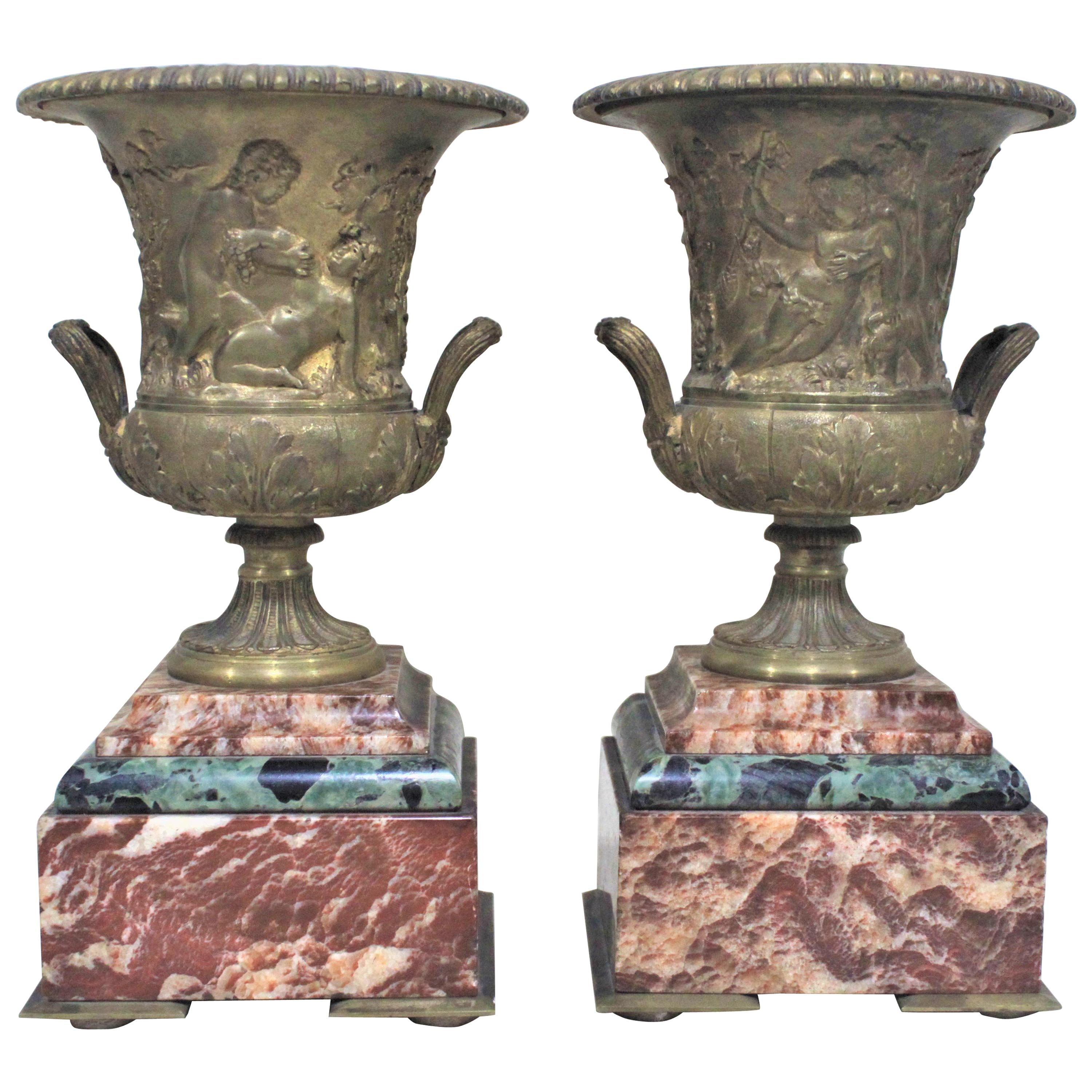 Pair of Gilt Bronze and Polished Marble Garnitures or Urns