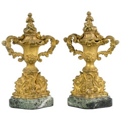 Pair of Gilt Bronze Two Handled Covered Urns on Marble Bases, French, circa 1890