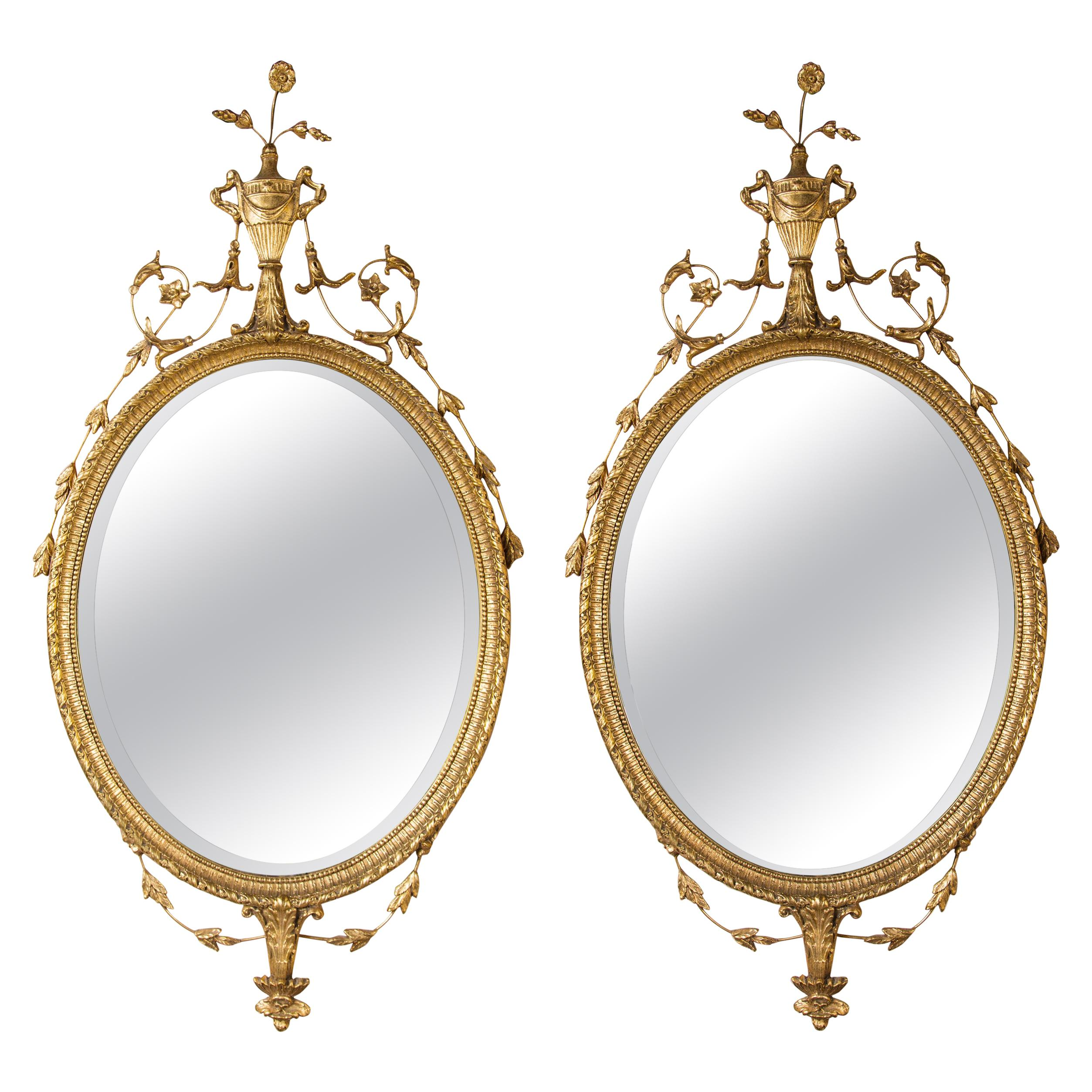 Pair of Giltwood George III Style Oval Mirrors