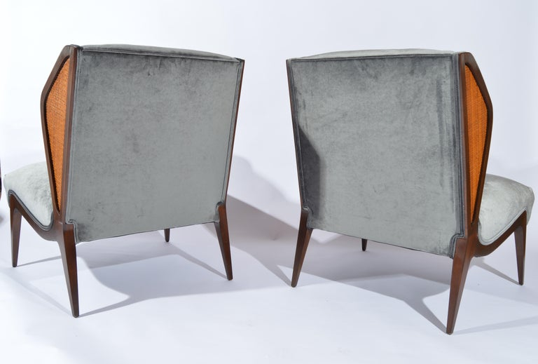 American Gio Ponti style Cane Embellished Wingback Easy Chairs in Walnut, circa 1955 For Sale