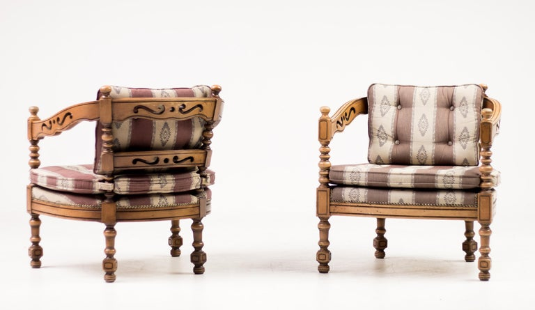 Distinguished Giorgetti armchairs of the 1975 Gallery collection. Rare classic Italian set of carved wood armchairs with original upholstery. Priced as a set. Marked.
