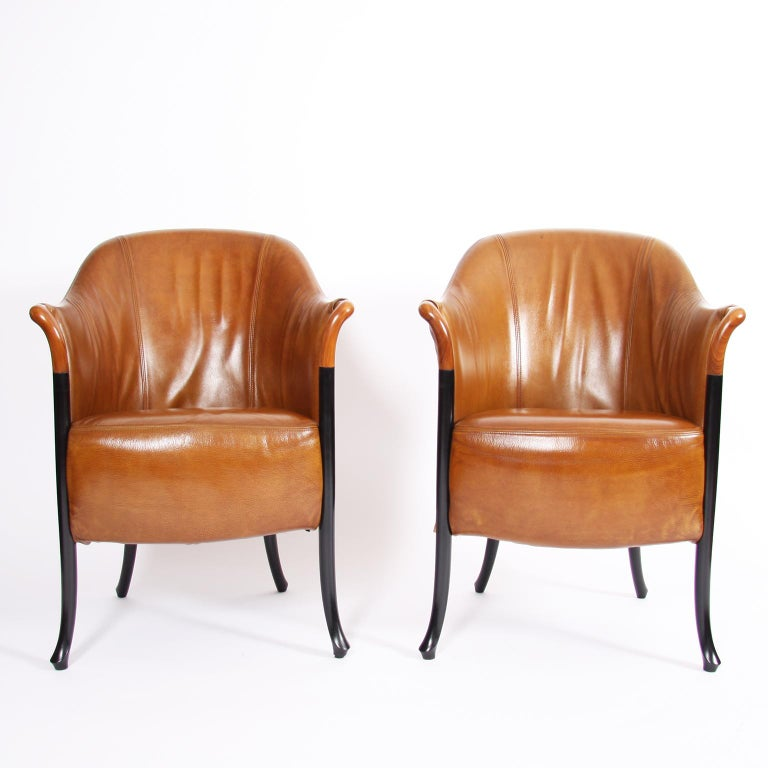 Italian, circa1980  A superb pair of tan leather armchairs, by Italian maker Giorgetti.  In excellent condition.   This quality armchair 'Progetti', by first class furniture manufacturer Giorgetti Italia, is upholstered in a soft