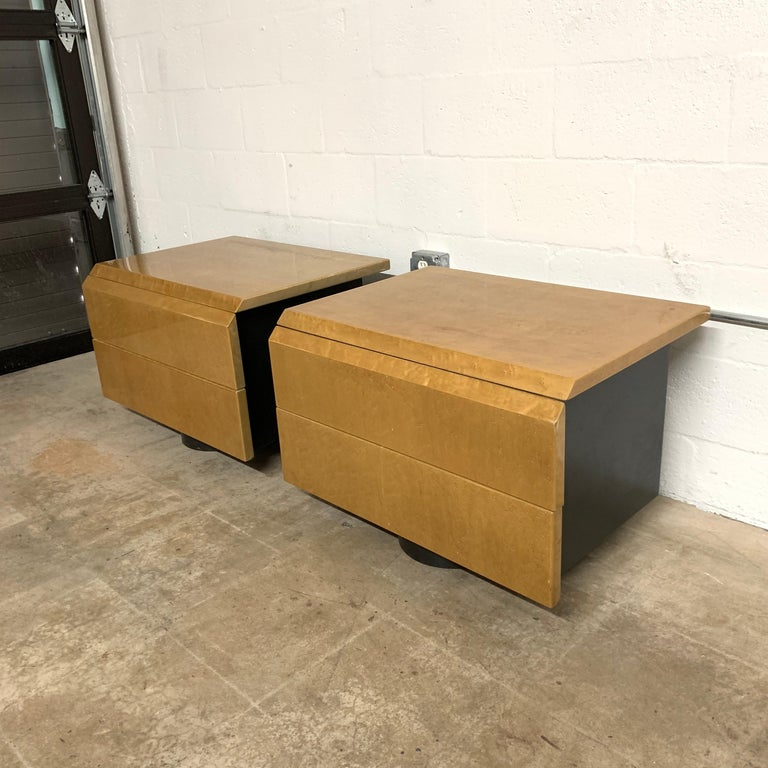 Postmodern nightstands or bedside tables rendered bird's-eye Maple drawer fronts and tops with an inset matte black case or frame and oval plinth base, top drawers have molded plastic dividers to assist in organization, designed by Giovani Offredi