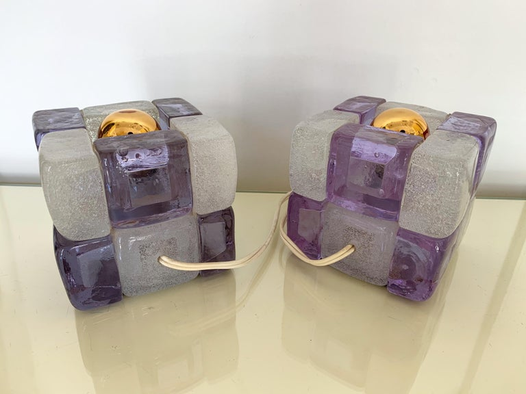 Nice pair of bedside or table lamps pressed glass cube by the manufacture Poliarte in light purple lila and clear bubble white. Work with all normal bulbs. Famous design like Mazzega Murano, Venini, Vistosi, Biancardi, Longobard.
