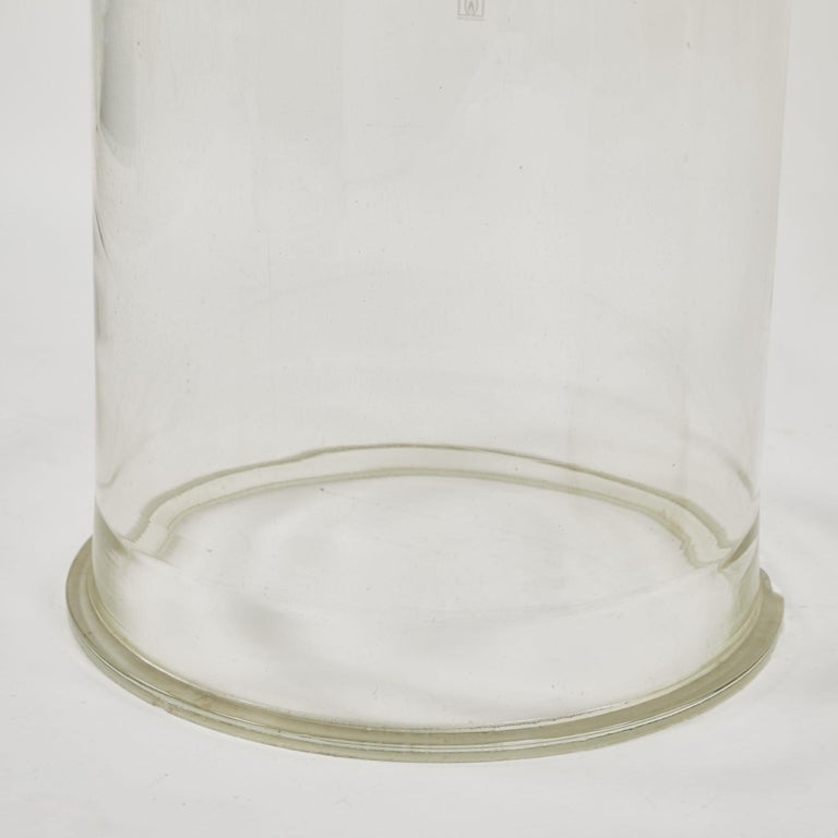 A pair of glass cylinders or plinths, originating in France, circa 1900.
