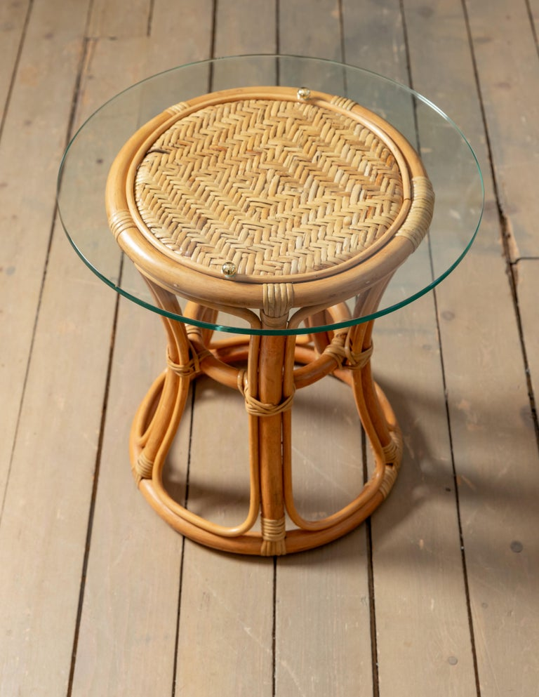 Italian Pair of Glass Top Rattan and Woven Wicker Tables with Brass Details For Sale