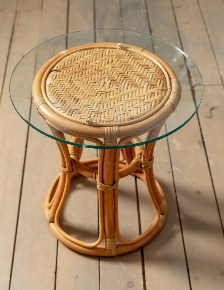 Pair of Glass Top Rattan and Woven Wicker Tables with Brass Details In Good Condition For Sale In Bridgehampton, NY