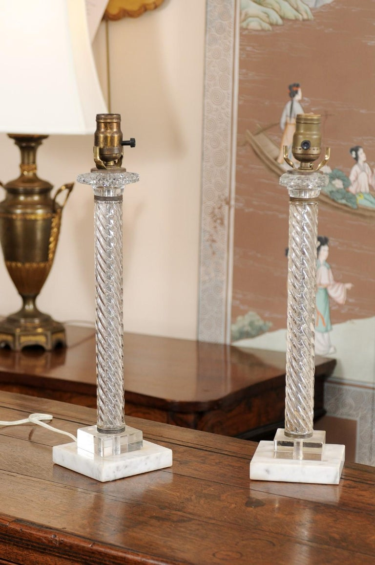 The pair of 20th century glass twisted column lamps with alabaster square bases.