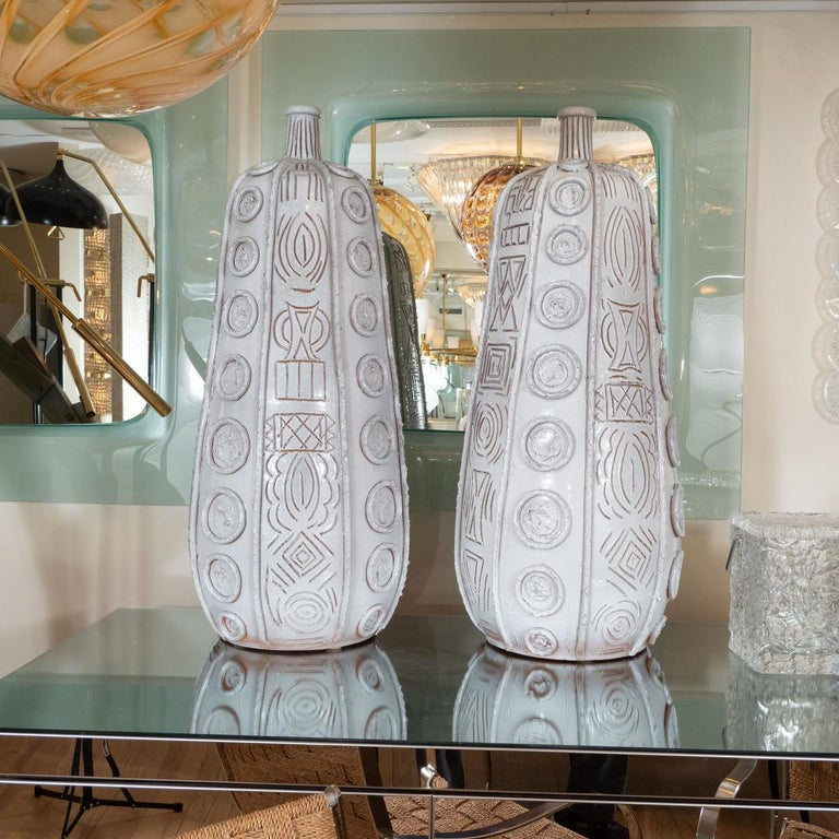 Pair of glazed and incised terra cotta tall vases by Duca Di Comastra.