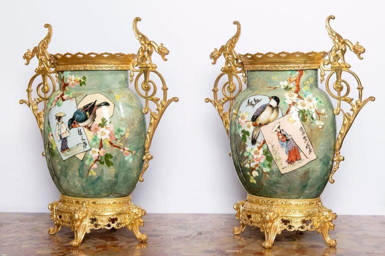Pair of glazed ceramic and gilt bronze vases, France, late 19th century.