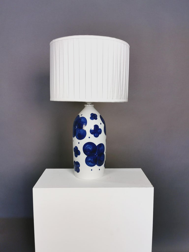 A pair of glazed ceramic table lamps by Swedish artist Sylvia Leuchovius. New handmade plissé shades in silk with top diffuser. Rewired. Manufactured by Rörstrand. Signed. Measures: 40cm high without the shades.