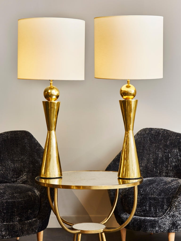 Pair of beautiful tall table lamps made of plaster covered with gold leaf.