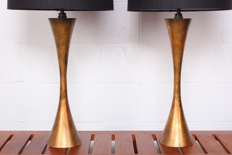 A pair of gold leaf table lamps designed by Stewart Ross James for Hansen.