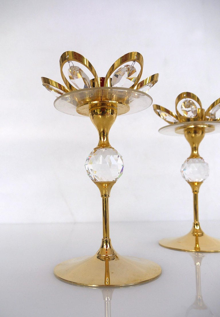 Pair of 24-karat gold-plated crystal glass candleholder by Lövsjö, Sweden.
