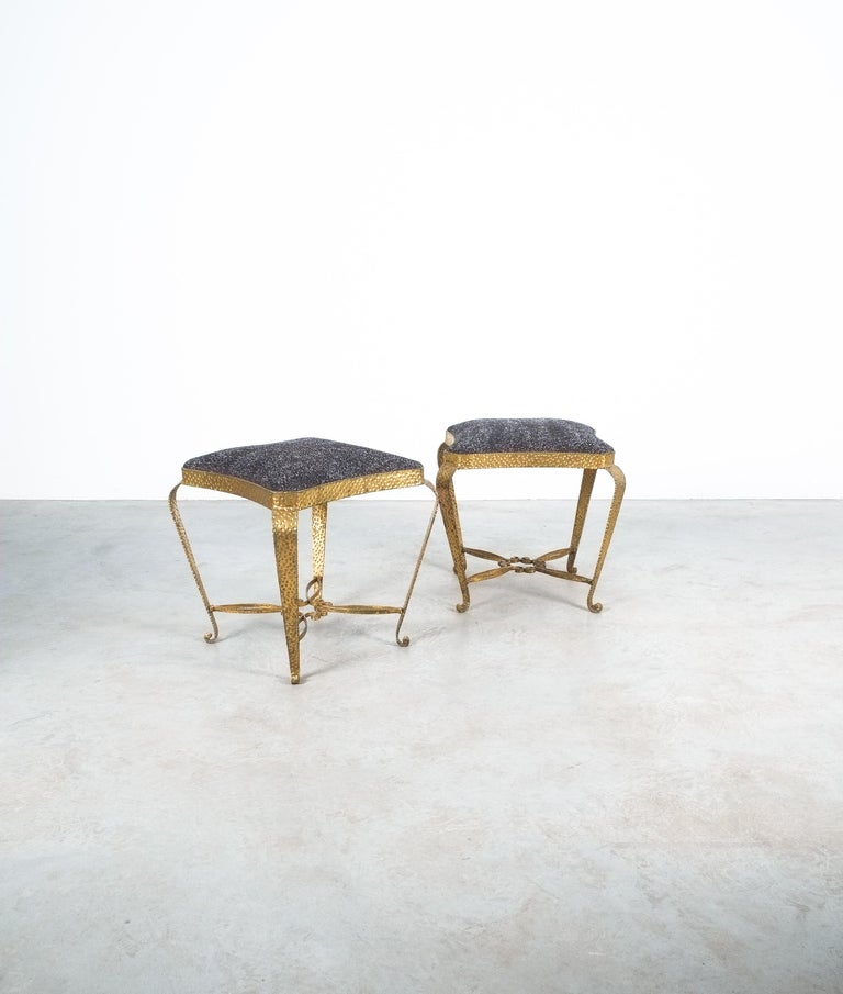 Pair of golden Pier Luigi Colliiron bedroom stools, Italy, 1950- priced as a pair  Nice pair of newly upholstered golden pier Luigi Colli iron bedroom stools, Italy, 1950. Cute pair of hammered gilt iron benches. We upholstered the stools with