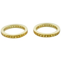 Pair of Golden Sapphire Eternity Rings in 18 Karat Yellow Gold