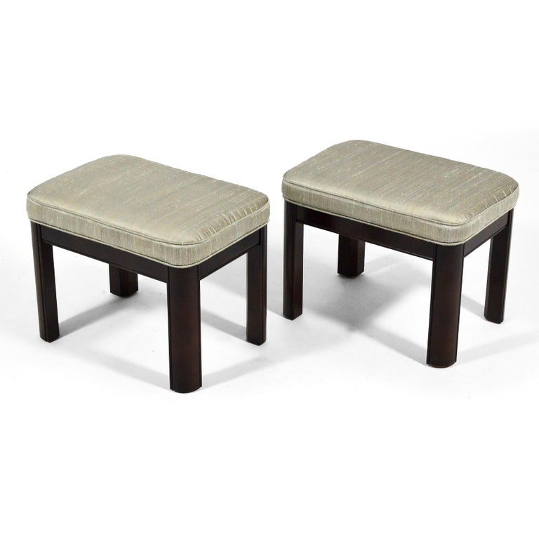 This handsome pair of stools by Gordon's Furniture have seats upholstered in silk supported by mahogany bases.