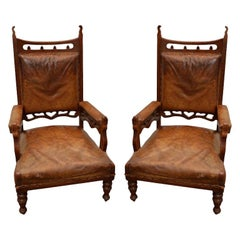 Pair of Gothic Style Brown Leather and Oak Armchairs
