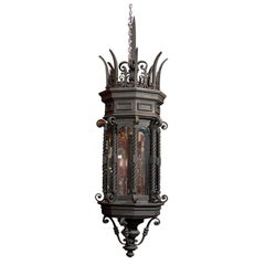 Pair of Gothic style iron lanterns with brackets
