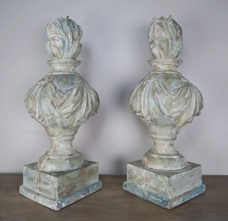 Pair of 19th century carved wood painted flamed finials. They are perfect for lamps as well but we are selling the pair as decor.