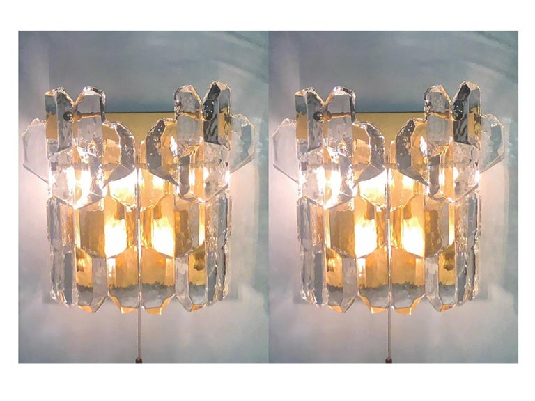 Beautiful pair of wall sconces by J.T. Kalmar, Austria, Vienna, 1960s. Made of each six heavy ice glass elements hanging on a gilt brass frame. Socket: Each 3 x e14 (for standard screw bulbs).