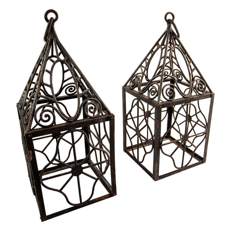 Pair of grand scale wrought iron hurricane lanterns in the style of Edgar Brandt For Sale