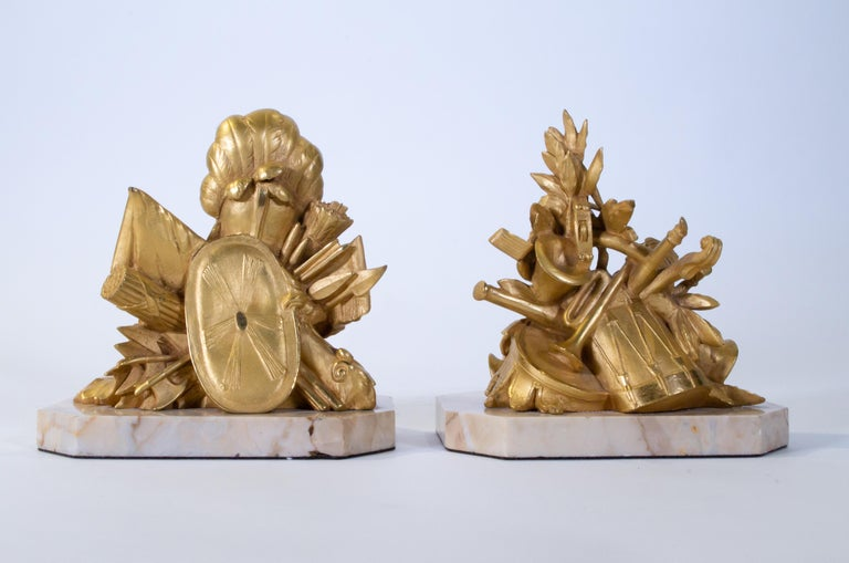 A pair of antique 19th century Louis XVI style marble mounted dore bronze armorial Bookends/paperweights depicting
