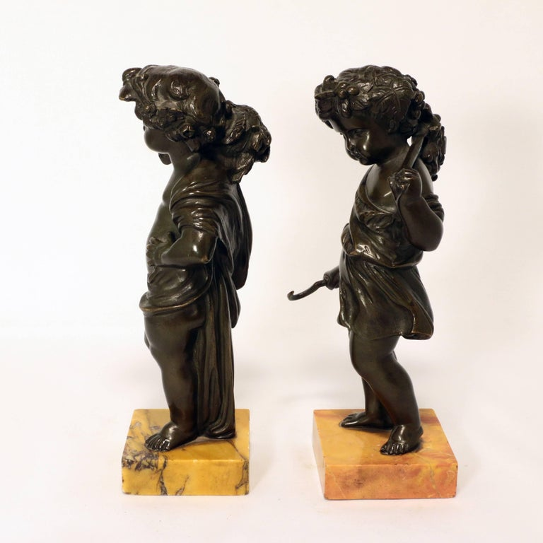 This charming young couple evoke summer in Italy. She with a bill hook and branch with fruiting vine, and her companion with a sheaf of wheat over his shoulder. Each is well modelled and stands on a square Siena marble base.