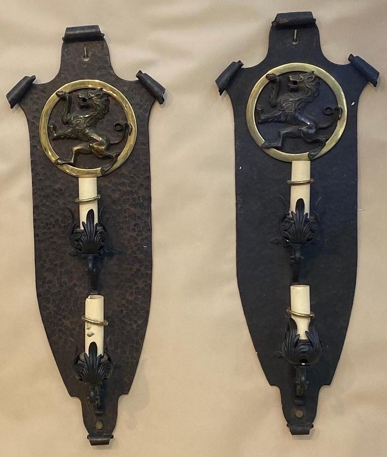 Pair of great quality hand hammered bronze and iron sconces, Oscar Bach style. Early 20th century   3 pair available.