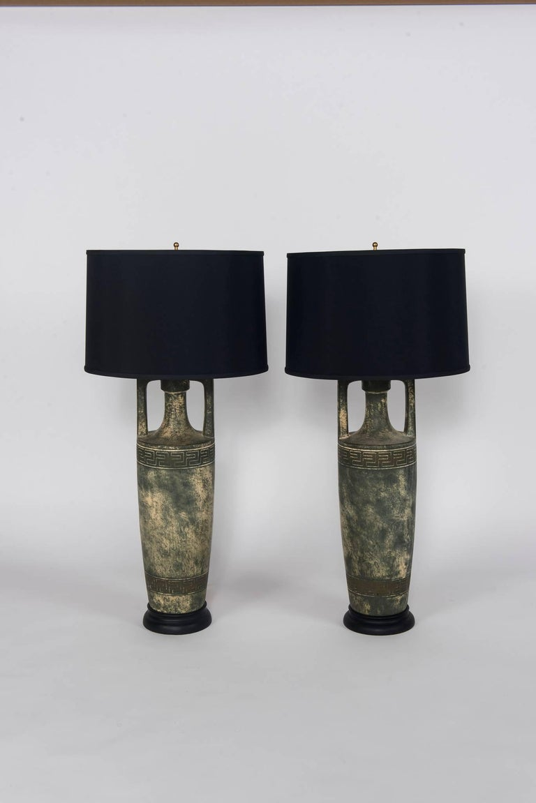 Pair of Greek key stoneware lamps with black shades.