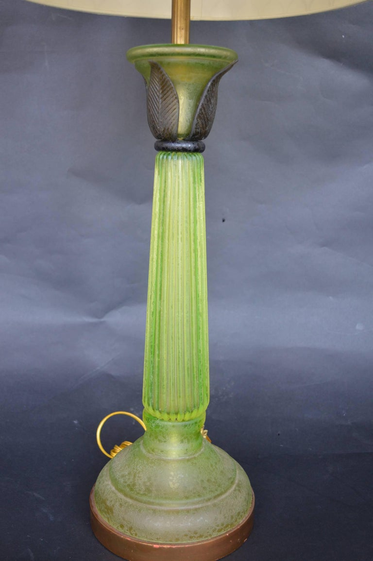Green glass lamps in the style of Daum.