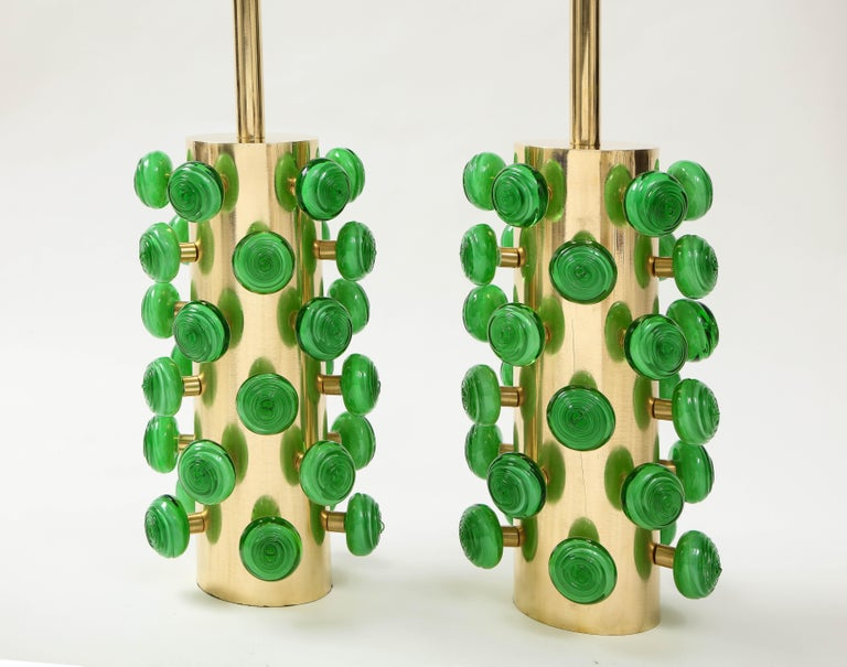 One of a kind pair of large sculptural brass cylinder lamps with Kelly green swirl glass knobs. Hand-casted Kelly green Murano round glass with a swirl texture are screwed on brass stems projecting from the base, thereby creating a 3 dimensional