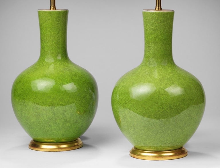 A fine pair of small bright green craquellure straight necked vases, now mounted as a lamps. Ideal for beside tables, or those smaller spaces.