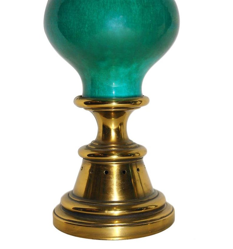 Pair of circa 1940s Italian green porcelain table lamps with bronze bases.  Measurements: Height of body: 18.5? Widest point: 8.5?.