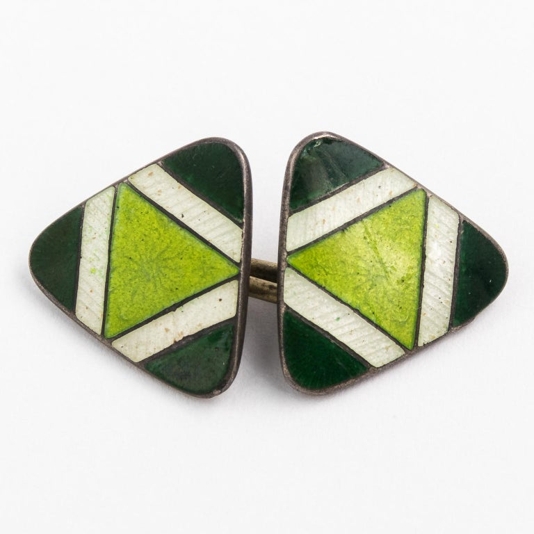Circa 20th century pair of Green enamel painted cufflinks in Sterling Silver with matching box.
