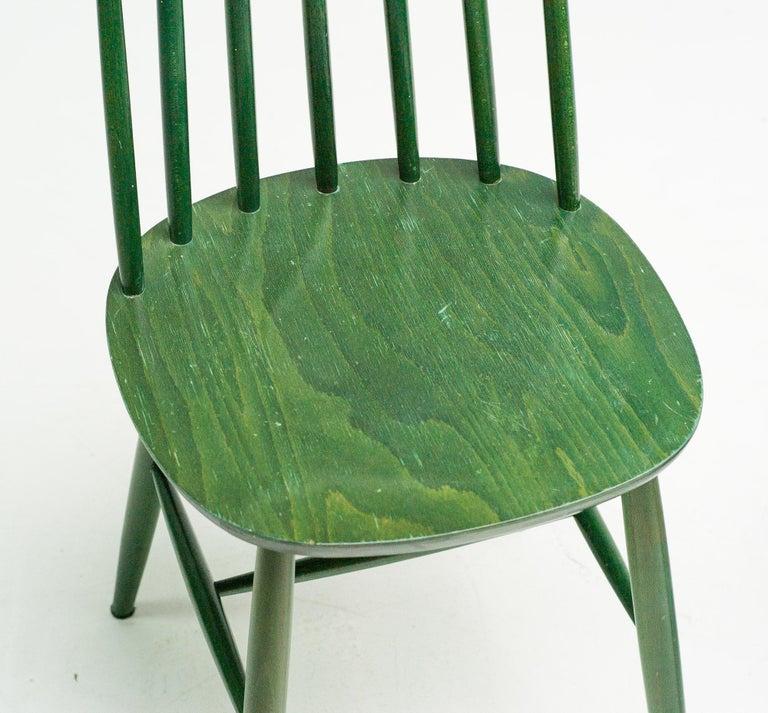 Pair of green dye spindle back dining chairs by Ilmari Tapiovaara.