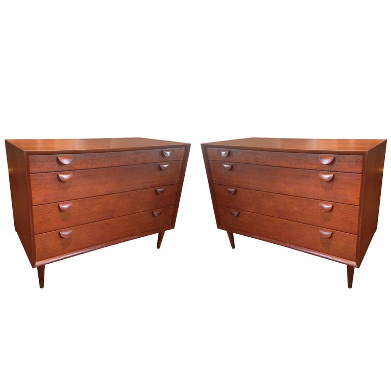 Handsome pair of four-drawer teak dressers with curved teak-veneer plywood pulls. With